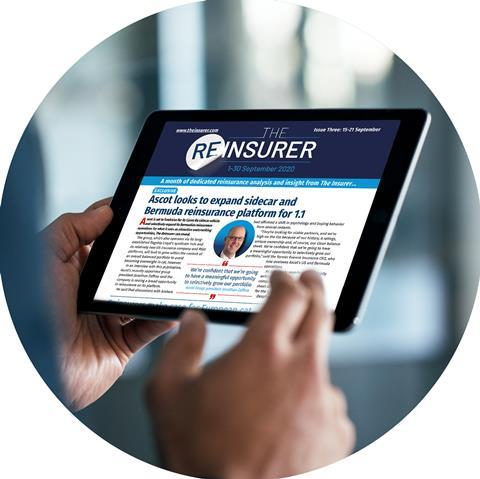 Photo of a person holding a tablet device with The Insurer website displaying